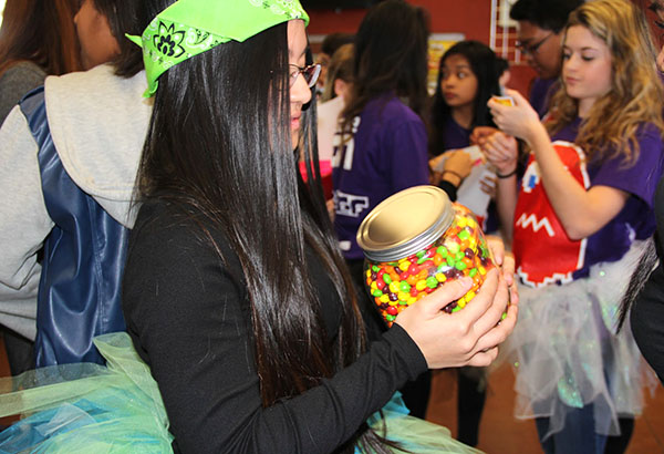 "Senior Kathleen Jaictin participates in the lunch games by playing tic-tac-toe and guessing how many skittles are in the jar. Along with those activities, trivia questions were also asked about the opposite sex for additional points. ""The games weren't easy, but we answered trivia questions correctly and earned some points for the girls,"" Jaictin said Photo Credit: Mika Pagado"