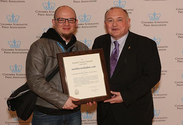 Journalism adviser Mr. Matthew LaPorte accepted the 2015 CSPA Gold Crown at the 91st Scholastic Convention at the Convocation Ceremony on Feb. 20.  Columbia Scholastic Press Association (CSPA) Director Edmund J. Sullivan presented the award to LaPorte.  Photo Courtesy of Columbia Scholastic Press Association