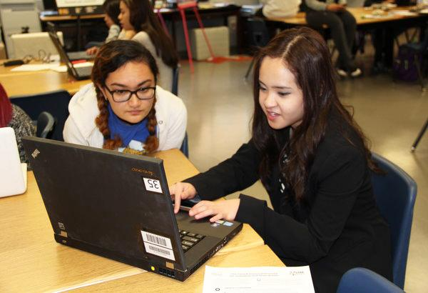 "Seniors Victoria Bonanno and Maria Patricia Cruz work on their competitive event in order to prepare for the FCCLA State Leadership Conference in Reno. They will be attending SLC from Mar. 10-12. ""I'm really excited for state since this is my first and last time competing. I'm not too focused on winning. I will work hard, but I also want to enjoy it,"" Dela Rosa said. Photo Credit: Helen Abraha"