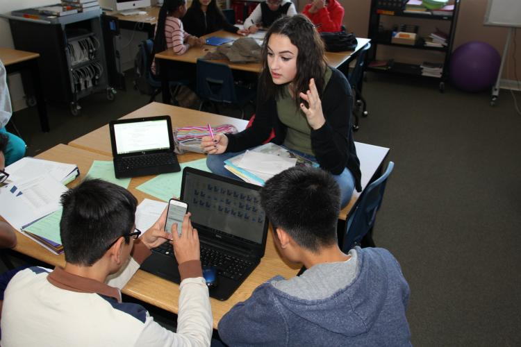 Sophomore Ali Balooch discusses how to effectively plan time for presentations with her group members sophomores Rey Vunanan and Sebastian Avalos.