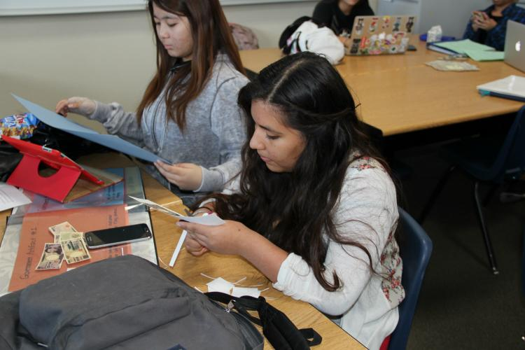 Sophomores Brenda Sosa and Jadylyn Delacruz create money and maps for their civilizations.