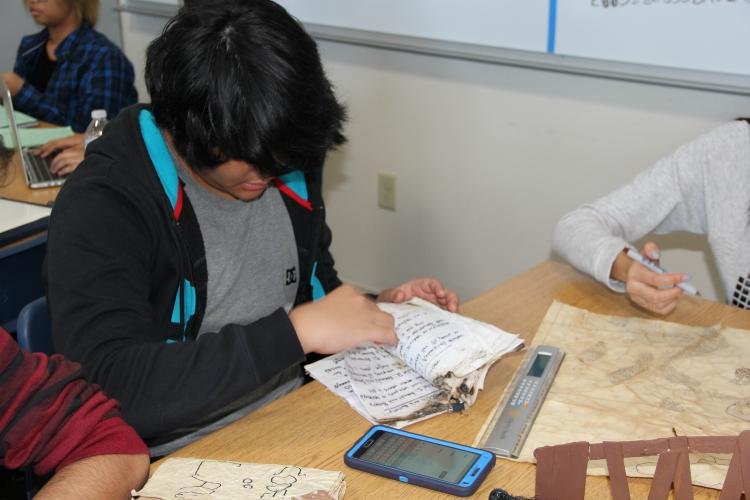 Sophomore Shawn Rouhani takes another look at the artifact his group created.