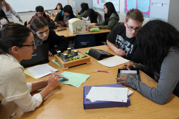 Mrs. Brant discusses the progress of sophomores Brkiti Brhan, Tyler Bryant-Juarez and Meric Pittman's civilization.