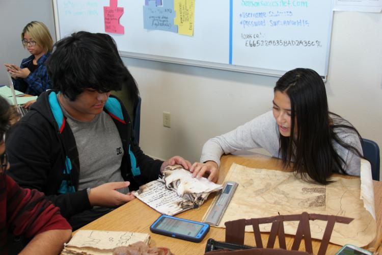 Sophomores Shawn Rouhani and Sarah Rivera finalize artifacts for their group's project.