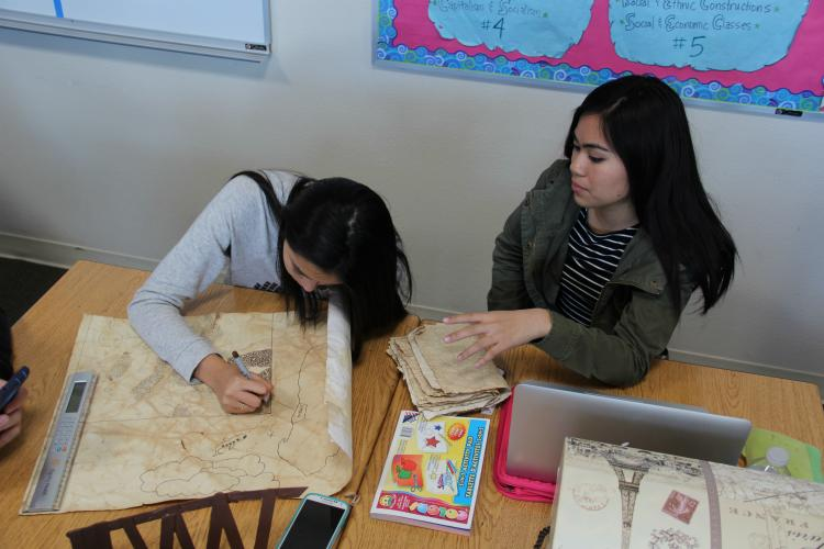 Sophomores Sarah Rivera and Jenny Nguyen collaborate on creating a map for their project.