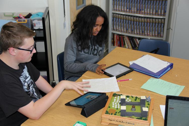 Sophomores Brkiti Brhan and Tyler Bryant-Juarez go over final preparations for their presentation.