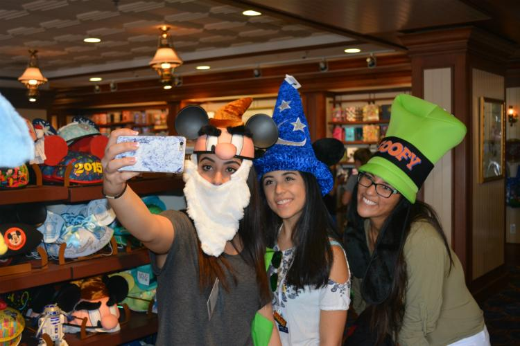 "Atena Sadri, Daniela Ornelas and Sathya Raghavan from Seven Lakes High School pose in silly hats. They decided to step into the cool shop and take a look at the souvenirs while exploring the boardwalk. ""We just wanted to escape the humidity for a bit and ended up taking selfies in weird hats to make us laugh,"" Ornelas said."