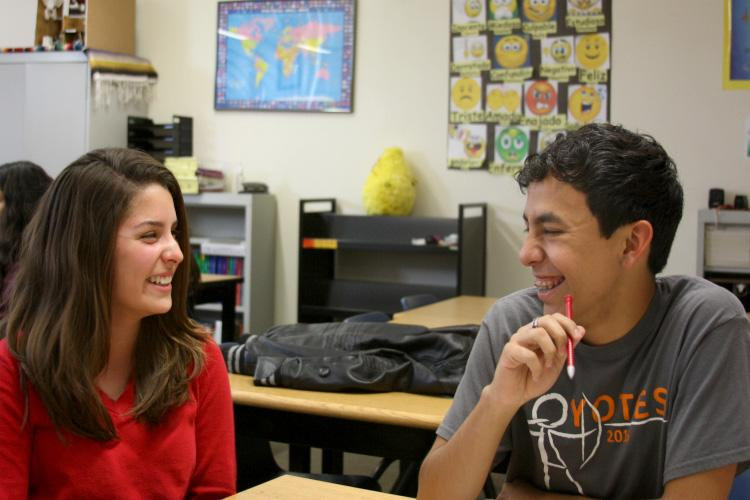 """Freshman Valeria Jimenez and junior David Recinos laugh, talk and work in their Spanish class. """"School stresses me out, especially right now with big projects. But what I like to do to relieve the stress is go to archery and actually do some after school clubs and I can be with my friends, I can talk and do some homework too and it's fun,"""" Recinos said. Photo Credit: Alyssa Ross"""