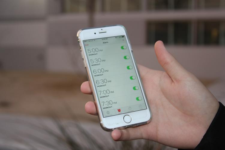Setting up your alarm for the day and time that you want to workout will help you.