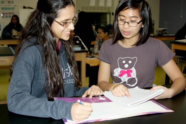 """Sophomores Julianne Torribio and Rosalia Sedano use time in class to study for their upcoming exams. """"I'm glad that my teacher gave us a few minutes to study for the exam, without it I would've had a hard time on the exam,"""" Torribio said."""