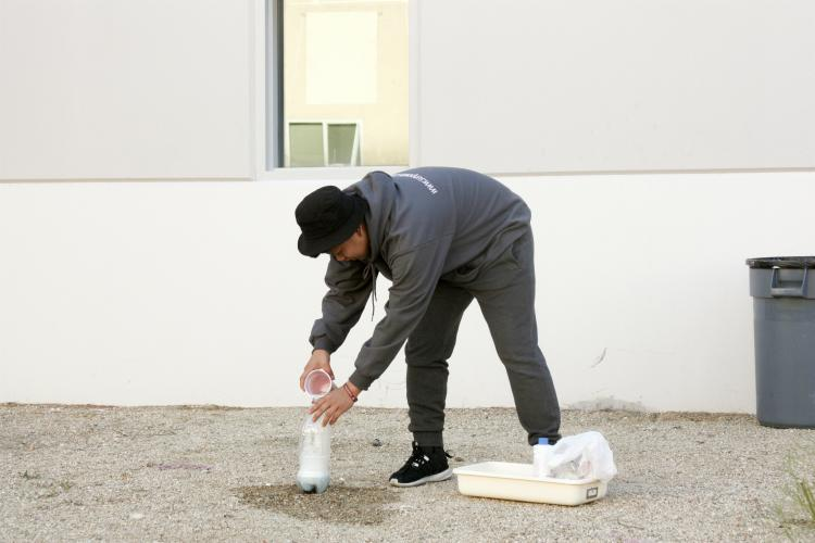 """Sophomore Jakob Aganon's demo takes place outside because of how messy it can get.  """"My lab was elephant's toothpaste and it creates foam and heat,"""" Aganon said."""