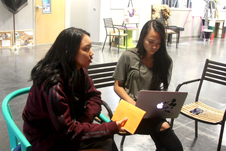 """Discussing the different aspects that need to be planned for Coyote Coachella are StuCo members Alexandra Nguyen and Kiana Gonatice. The two are part of the Dance Commission, which is in charge of organizing the event. """"We've been starting to set things up and make decorations since last week,"""" Nguyen said. """"Today we are finishing our posters and our photo-op places, and things like that."""""""